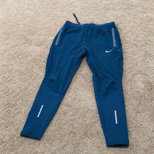 Nike teal medium athletic sports tights .